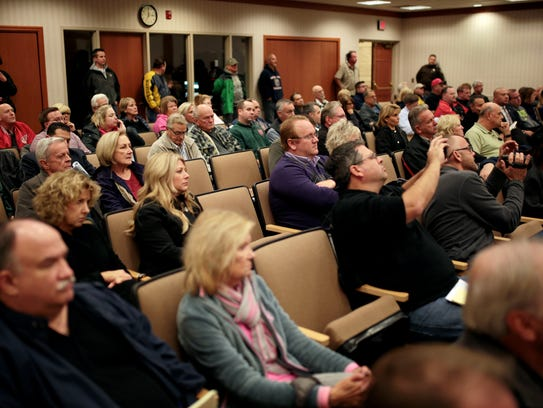 People attend Macomb Township Board of Trustees meeting