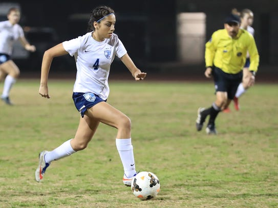 Redwood's Marisa Perez dribbles up-field against Golden