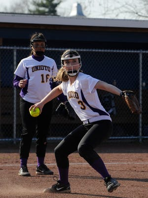 Unioto's Brooke Blevins throws the ball to first during Unioto's game against Chillicothe on Tuesday afternoon at Mount Logan Elementary School in Chillicothe. The Shermans defeated the Cavaliers 8-3.