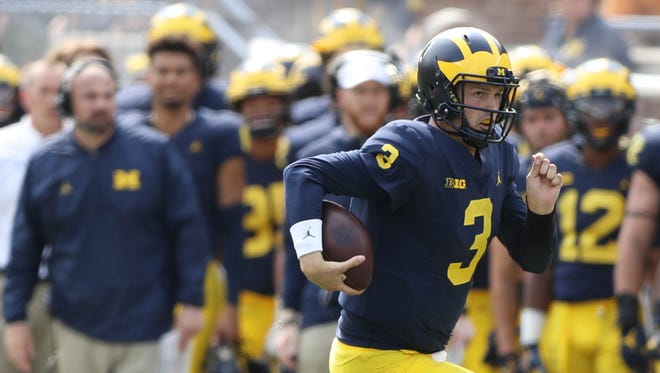 Wilton Speight scrambles in the third quarter of Michigan's 29-13 win over Air Force, Saturday, Sept. 16, 2017 at Michigan Stadium.