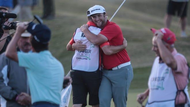 Jon Rahm hugs his caddy Adam Hayes after winning the CareerBuilder Challenge on Sunday, January 21, 2018 in La Quinta, CA.