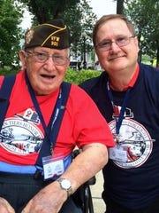 World War II veteran Leo Krolak, left, and his son,