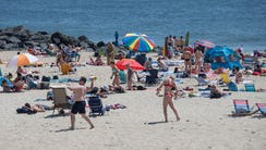 People flock to the beach in Long Branch to enjoy the