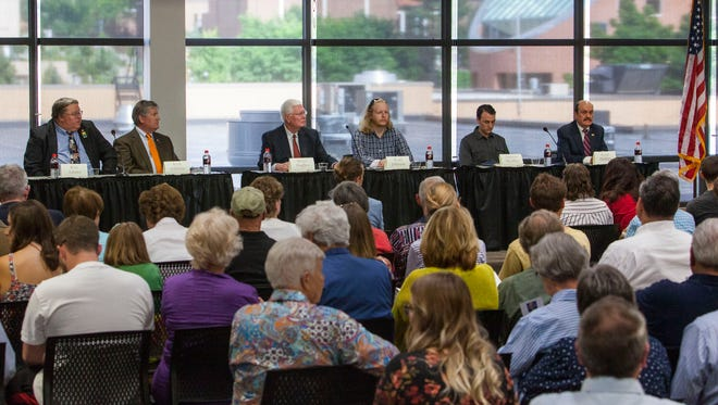 Candidates for city council in Cedar City sit on stage during a debate held at Southern Utah University by the Michael O. Leavitt Center for Politics & Public Service, Tuesday, July 25, 2017.