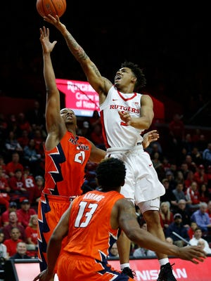Mar 4, 2017; Piscataway, NJ, USA; Rutgers Scarlet Knights guard Corey Sanders (3) goes to the basket against Illinois Fighting Illini guard Malcolm Hill (21) and Illinois Fighting Illini guard Tracy Abrams (13) during second half at Louis Brown Athletic Center. Rutgers Scarlet Knights defeated Illinois Fighting Illini 62-59. Mandatory Credit: Noah K. Murray-USA TODAY Sports