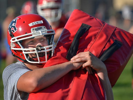 Milaca junior Dylan Ash hits a bag during defensive practice Wednesday, Aug. 17 at Milaca High School.