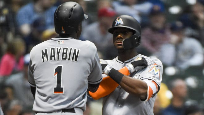 Former Brewers top pick Lewis Brinson (right), whom the Marlins acquired in the offseason in a trade that sent Christian Yelich to Milwaukee, celebrates with teammate Cameron Maybin after hitting a two-run shot in the fifth inning on Thursday. It was Brinson's second homer of the night, and he drove in all of Miami's runs in the game.