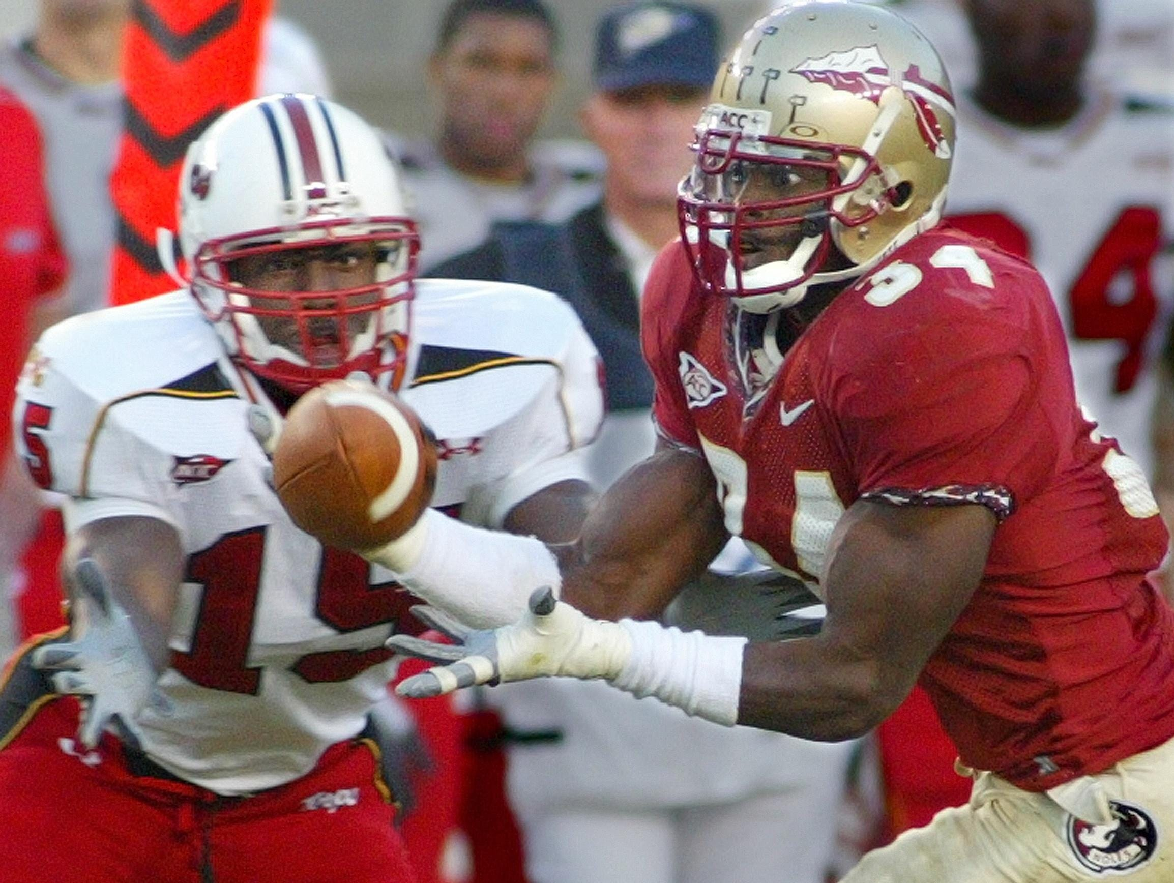 FSU's Ernie Sims (34) steps in front of Maryland's Jason Goode to intercept a pass in the fourth quarter of a 2005 game.