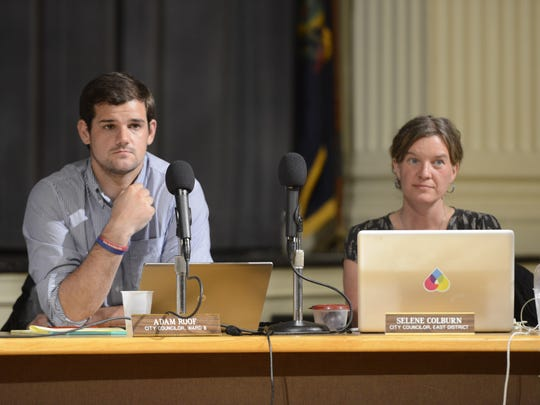 Burlington City Councilor Adam Roof, left, recently introduced a resolution to rid the council and city government positions of party affiliations.