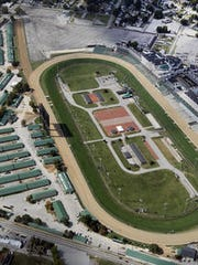 Churchill Downs to add premium seating.
