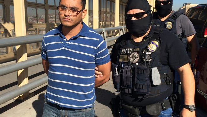 Immigration and Customs Enforcement officials turned over Jose Refugio Gonzalez-Gaytan, 37, to Mexican authorities at the top of the Stanton Street Bridge on Wednesday, officials said. He is accused in a May 2014 homicide.