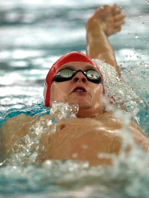 Neenah's Eli Rocke competes in the 200-meter individual medley against Appleton West/Kimberly during a dual meet Tuesday in Appleton.