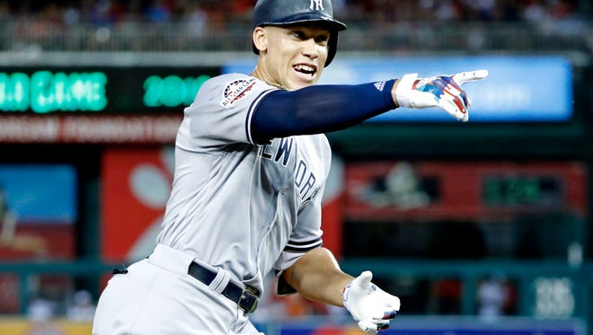 Jul 17, 2018; Washington, DC, USA; American League outfielder Aaron Judge of the New York Yankees (99) celebrates after hitting a home run during the second inning in the 2018 MLB All Star Game at Nationals Ballpark. Mandatory Credit: Geoff Burke-USA TODAY Sports