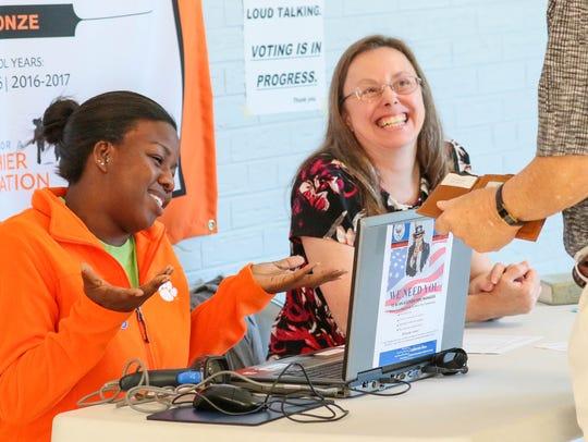 Natasha Scott, left, and Jenny Moline, poll managers