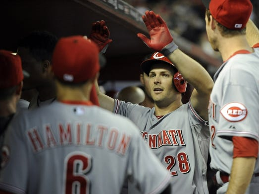 Chris Heisey (28) celebrates a home run with teammates in the fifth inning against the Arizona Diamondbacks at Chase Field.