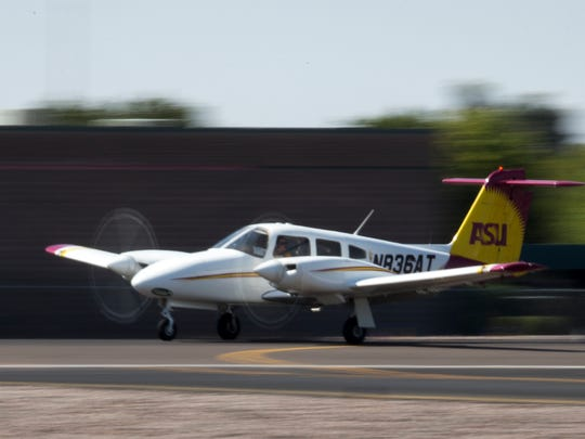 Small planes land at the Scottsdale Airport on Wednesday, May 14, 2014. Scottsdale has seen a remarkable increase in flights from out of the country this year, largely because U.S. Customs expanded its hours and added a second agent at the airport.