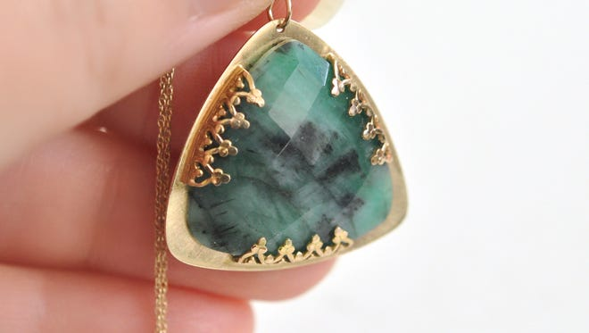 An emerald and 14K-gold pendant by Diana Fakhoury.