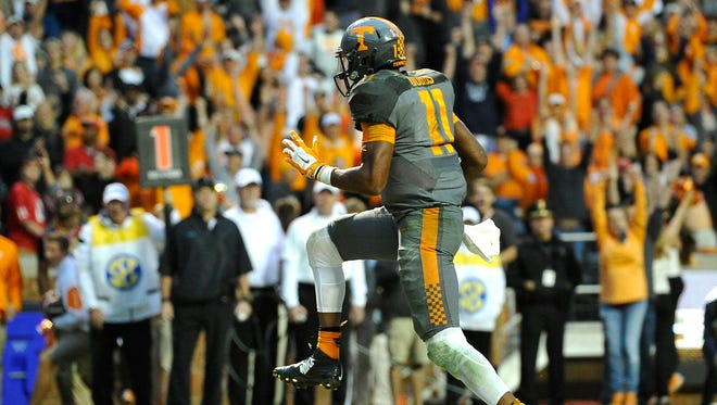 Tennessee quarterback Josh Dobbs (11) tiptoes in for a touchdown against Georgia  on Oct. 10, 2015.