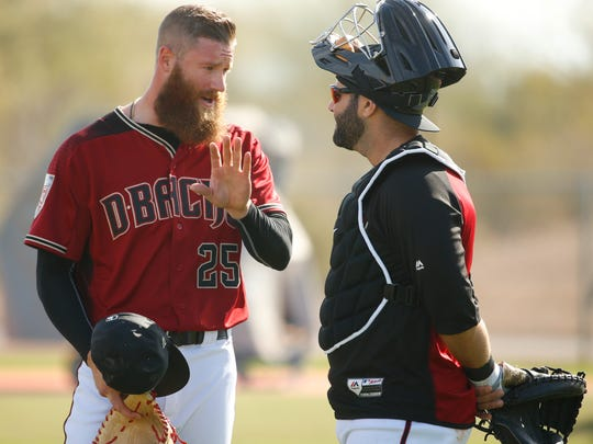 Diamondbacks Archie Bradley (25) talks with catcher Alex Avila during Spring Training at Salt River Fields at Talking Stick on February 17, 2018.