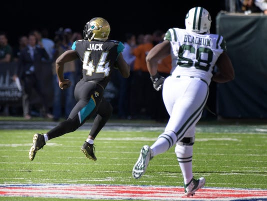 Jacksonville Jaguars' Myles Jack, left, scores a touchdown after recovering fumble during the second half of an NFL football game against the New York Jets, Sunday, Oct. 1, 2017, in East Rutherford, N.J. (AP Photo/Bill Kostroun)