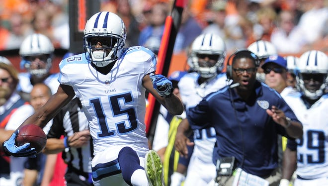 Titans wide receiver Justin Hunter (15) speeds past the Bengals defense after making a catch during the second quarter at Paul Brown Stadium Sunday Sept. 21, 2014, in Cincinnati , Oh.
