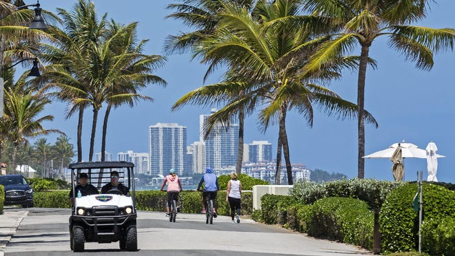 Palm Beach police monitor the beaches along North Ocean Boulevard in the North End on Sunday after numerous complaints about illegal use of public beach areas and the lack of social distancing.