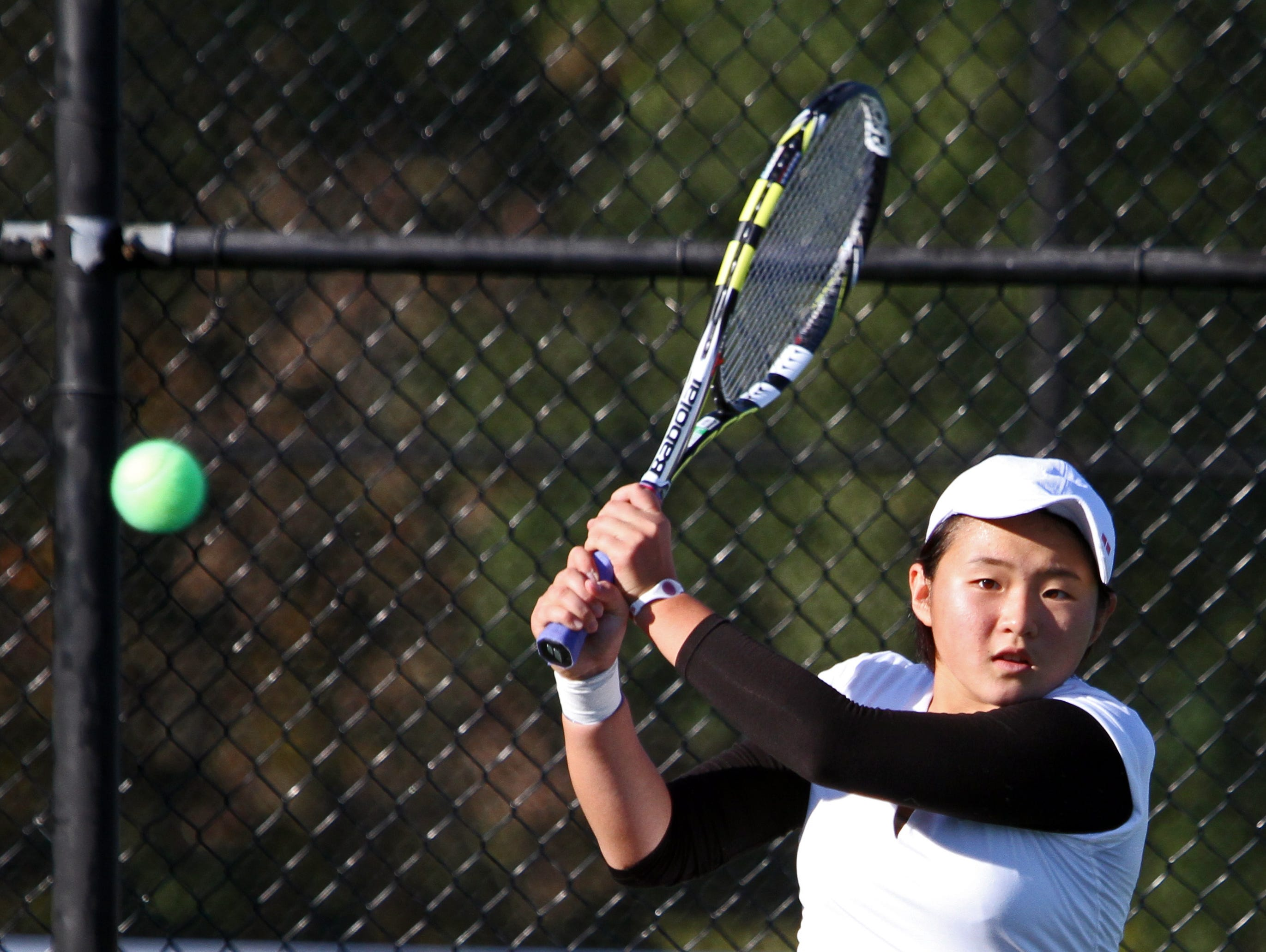 Second seeded Mayu Tezuka of Keio returns a shot to Lily Grantcharova of New Rochelle during the Section 1 Girls' Tennis Singles Championship Tournament at Harrison High School Oct. 20, 2015.