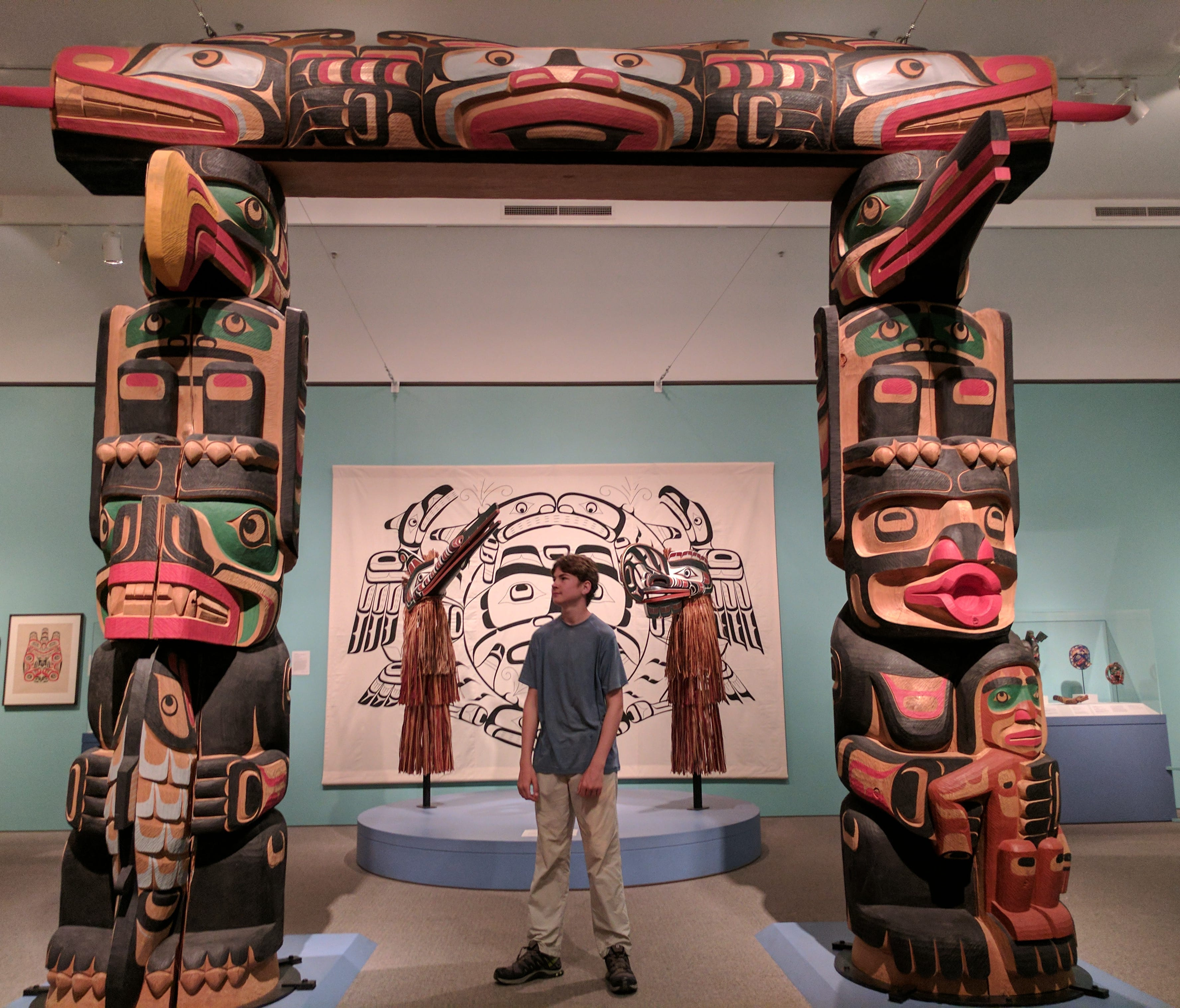 Aren Elliott inspects a Native American carving at the Cantor Arts Center on the campus of Stanford University in Palo Alto, California. Art museums can be a great alternative to the train-plane options, if your kids are up for it.