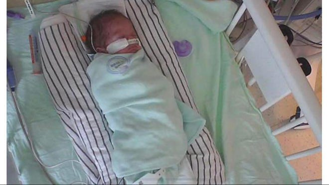 Newborn Mayzie Faith Audby is being cared for in the NICU of Children's Mercy Hospital in Kansas City, Missouri. A Gofundme page has been established to help the family.