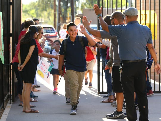Teachers welcome back sixth-grade student Pedro Molina on May 4, 2018, at Eisenhower Center for Innovation in Mesa. The #RedForEd teacher walkout kept many Arizona schools closed for six days.