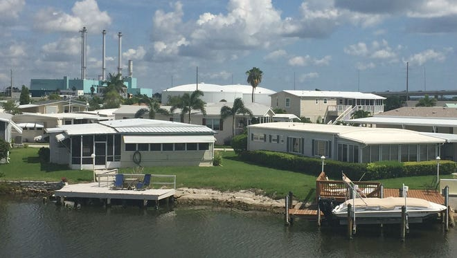 Vero Beach's power and sewer plants are part of the view looking north from Joey Stawara's home in Fairlane Harbor June 26, 2017. Stawara, who manages his family's manufactured home community, would like to see city-owned land housing the plants become a fun destination once they are demolished.