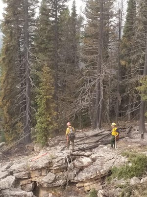 """A pair firefighters from the New Jersey Forest Fire Service surveys the """"Freeze Out"""" fire in Bighorn National Forest in Wyoming earlier this month. [Photo courtesy New Jersey Forest Fire Service}"""