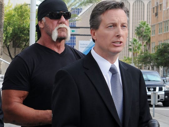 TV personality Terry Bollea aka Hulk Hogan(L) and his attorney Charles Harder (R) attend for a press conference to discuss legal action being brought on his behalf October 15, 2012 in Tampa, Florida.  Counsel will discuss the two civil lawsuits suits being filed today.  The first is a state court action against Heather Clem and Bubba the Love Sponge Clem. The second is a federal court action against Gawker Media.