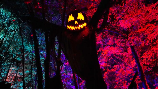 Tall scarecrows, jack-o-lanterns, and amazing light displays add to the spirit of Halloween at Haunted Overload at the DeMeritt Hill Farm in Lee.
