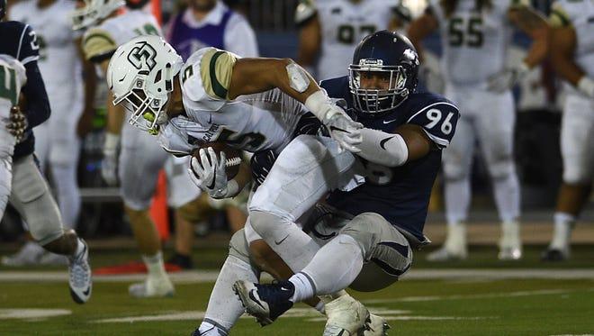 Nevada's Hausia Sekona tackles Cal Poly's Joe Protheroe during their game Friday night.
