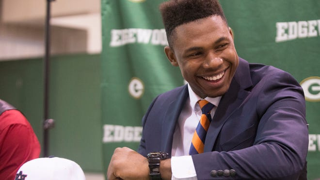 Prince Tega smiles while preparing to sign with Auburn University on Wednesday, Feb. 4, 2015, at Edgewood Academy outside Montgomery, Ala. Tega is an exchange student from Nigeria.