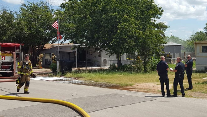 Abilene firefighters and police responded to a house fire Thursday morning.