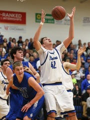 Simon Kenton's Zach Kelch attempts to pull in a rebound