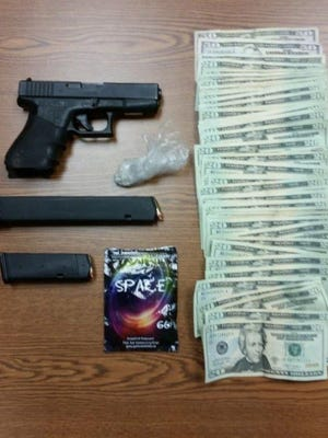 "Officers recovered a 9mm handgun and two grams of crack cocaine that Wells had ditched while he ran, along with a fully loaded 30 round magazine, synthetic marijuana or ""spice"" and over $1,100 in cash."
