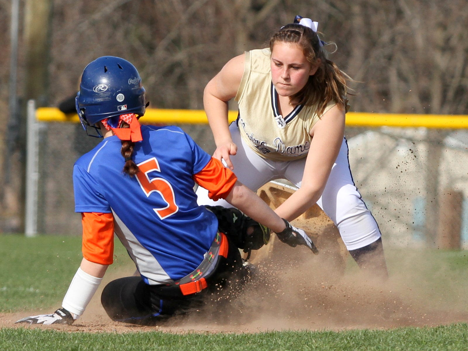 Edison's Kristina Lashick slides into second base with a double before Notre Dame shortstop Izzy Milazzo can apply the tag during Wednesday's IAC game.