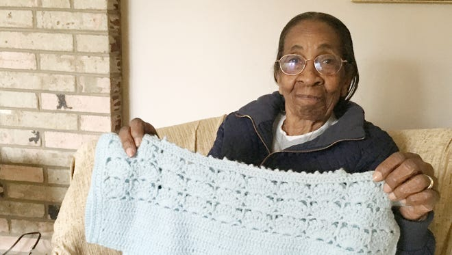 Gena Jackson will celebrate her 100th birthday soon. She was a tailor for many years, and holds a crocheted top she made.
