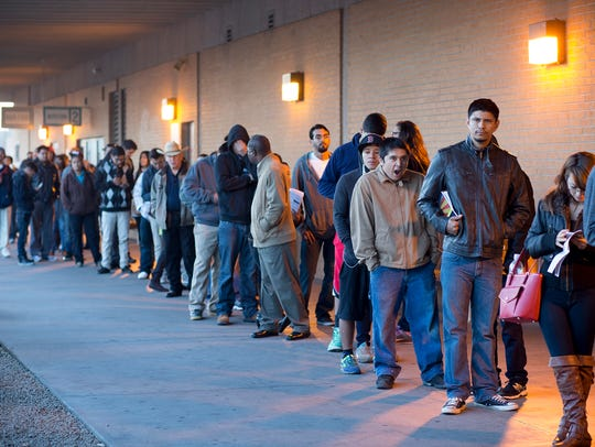 Dreamers wait in line at the Motor Vehicle Division