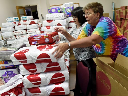 Cindy Happel, front and Brenda Black sort diapers.