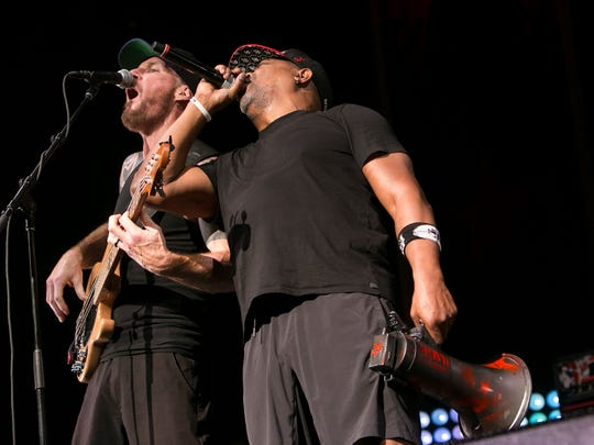 Tim Commerford and Chuck D of Prophets of Rage perform at Ak-Chin Pavilion in Phoenix on Sat, Sep. 17, 2016.