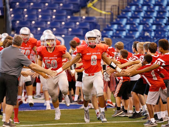 The West Lafayette Red Devils take the field to face