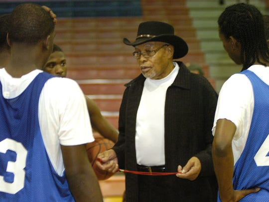 Tougaloo College Lafayette Stribling talks with his team. Stribling is taking only 7 players to the NAIA National Championship Tournament.