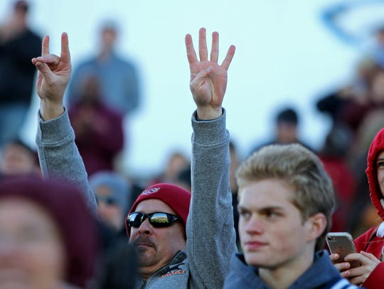 A Midwestern State fan holds up a 24 with his hands