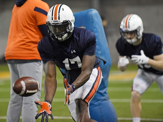 Auburn wide receiver Marquis McClain (17) makes a catch in drills Wednesday. First Auburn bowl practice on Wednesday, Dec. 27, 2017 in Atlanta, GA.