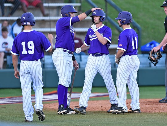 Tyler Smith (center) was the hero Sunday for Northwestern State.