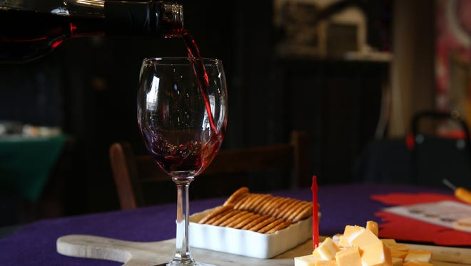 Wine is poured, Tuesday, Nov. 21, 2017, at Meier's Winery in Silverton, Ohio.